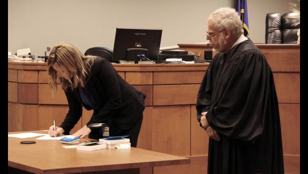 """Crystal Brucker Kocher makes it official during a swearing-in ceremony on Friday. She was appointed Pulaski Superior Court Judge by Governor Eric Holcomb last week. Brucker Kocher's daughter Hailey officially """"robed"""" her mother for the first time, keeping with the tradition started by Pulaski Circuit Court Judge Michael Shurn, who was robed by his son when he was sworn in."""