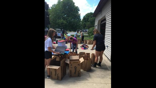 Members of the First United Methodist Church Sunday school helped organize and pack the backpacks on Sunday. Photo Submitted