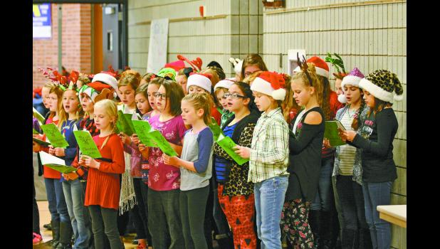 The EPES ExPrEsS choir got everyone in the holiday spirit during breakfast with Santa.