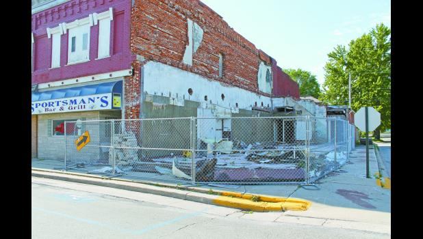 The fence surrounding the Sportsman's Bar and Grill is beginning to block the sidewalk and could soon be in the street. Commissioners discussed the issue on Monday because the fence belongs to the county.