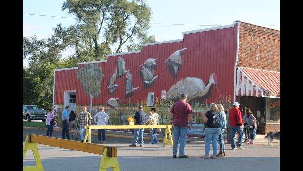 A large group gathered to help celebrate the completion of phase two of the Medaryville Crane Mural on Saturday, Oct. 9.
