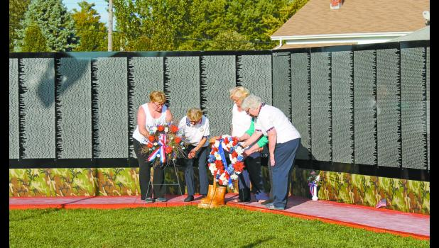 Ladies of the American Legion Auxiliary placed wreaths at the Vietnam Traveling Memorial Wall that was assembled in Francesville during the fall festival last weekend, in remembrance and honor of those who served.
