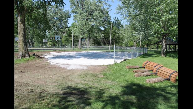 A base has been created for a new surface in the toddler playground area and all the equipment has been removed for new pieces.