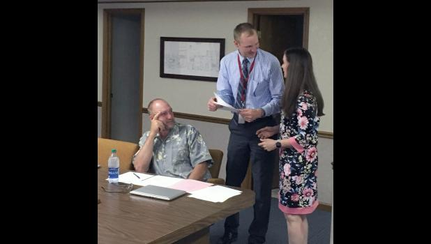 Angie Radtke signed her administrative contract with West Central School Corporation on July 11 as she was hired as the new assistant principal. School boardman Jeff Lowry and superintendent Dan Zylstra welcomed her.