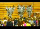 To the delight of EPES students Susie Schultz, Jill Collins and Maureen Garrity hang suspended from the gymnasium bleachers.